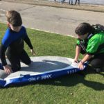 Deflating paddleboard at Lochore