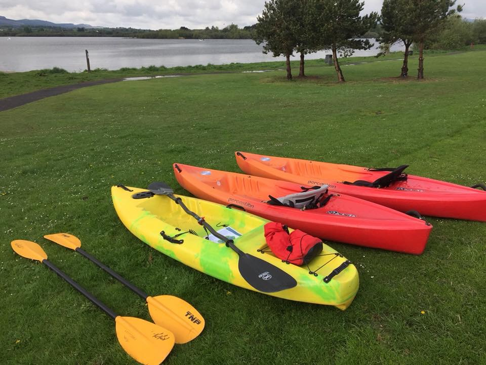 Picture of sit on kayaks on grass beside loch